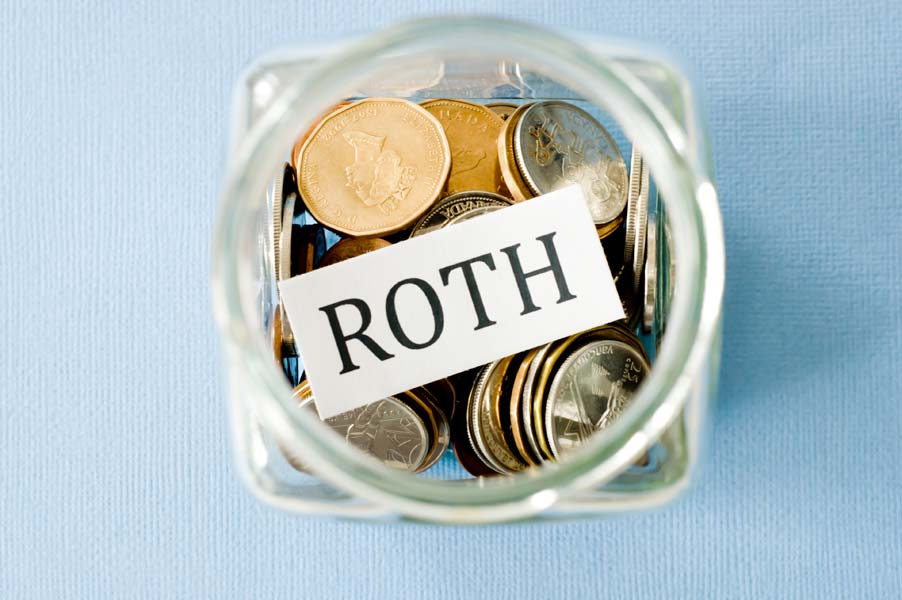 Roth IRA in jar full of coins